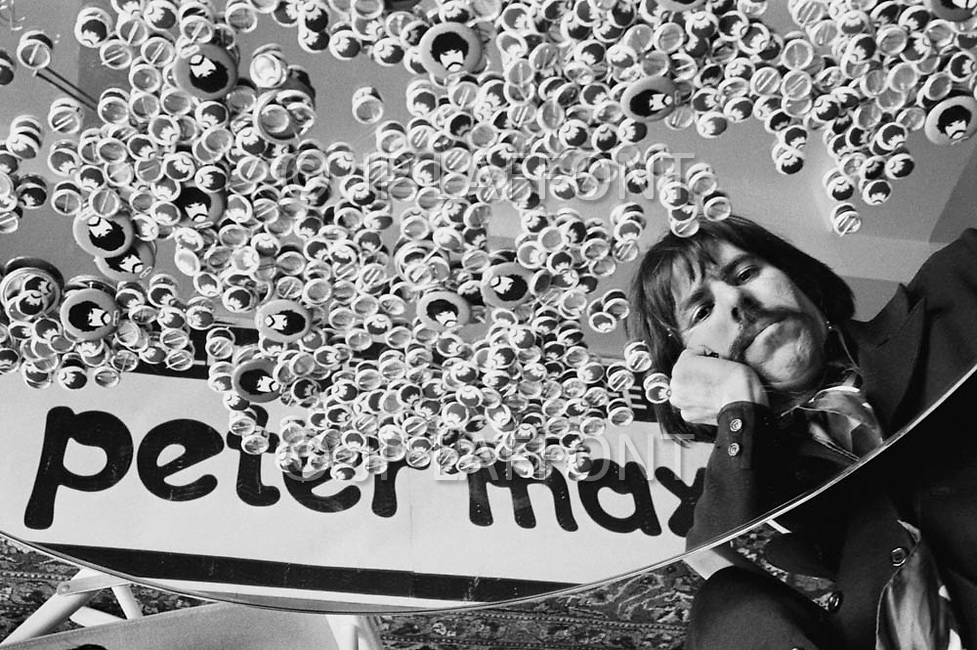 "New York City, USA. April 1969. American artist and inventor of the ""poster"" Peter Max at home in New York City in 1969 with pins on a mirror. Max combined the techniques of neo expressionism and vibrant use of color to depict contemporary American culture."