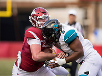 Hawgs Illustrated/BEN GOFF <br /> Cole Kelley, Arkansas quarterback, goes down in the backfield with Marcus Williamson (obscured), Coastal Carolina defensive end, and Shane Johnson, Coastal Carolina linebacker, on the tackle, in the second quarter Saturday, Nov. 4, 2017, at Reynolds Razorback Stadium in Fayetteville.