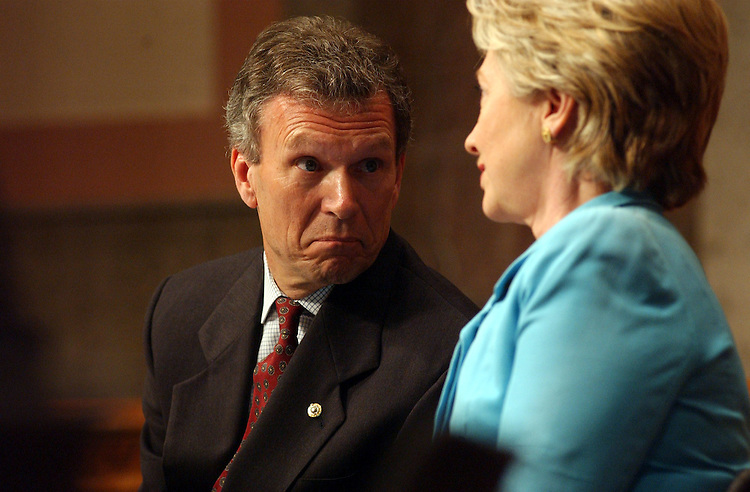 CBC11_062603 -- Tom Daschle, D-S.D., and Hillary Clinton, D-N.Y., talk during the African American leadership summit during a luncheon with the Congressional Black Caucus.