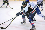 February 20, 2016 - Colorado Springs, Colorado, U.S. -   Robert Morris forward, Greg Gibson #16, works to control the puck during an NCAA ice hockey game between the Robert Morris University Colonials and the Air Force Academy Falcons at Cadet Ice Arena, United States Air Force Academy, Colorado Springs, Colorado.  Air Force defeats Robert Morris 4-1