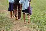 Barefoot Mayan children walk to school in Midway village, southern Belize.
