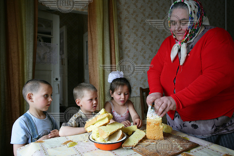 Three of the 10 children cared for by an elderly couple in their own home. All the children have been either orphaned or abandoned by their parents.