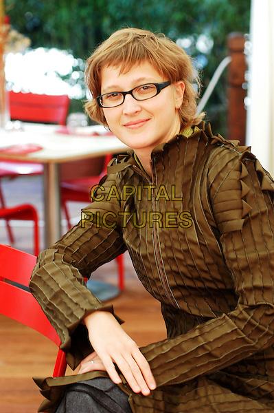 "JASMINA ZBANIC.Photocall for her film ""Il segreto di Esma"" at Casa del Cinema, Rome, Italy..October 26th, 2006.Ref: CAV.half length green top glasses pleated ruffles.www.capitalpictures.com.sales@capitalpictures.com.©Luca Cavallari/Capital Pictures."