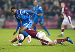 Hearts v St Johnstone...29.01.11  .Cleveland Taylor gets the better of Lee Wallace.Picture by Graeme Hart..Copyright Perthshire Picture Agency.Tel: 01738 623350  Mobile: 07990 594431