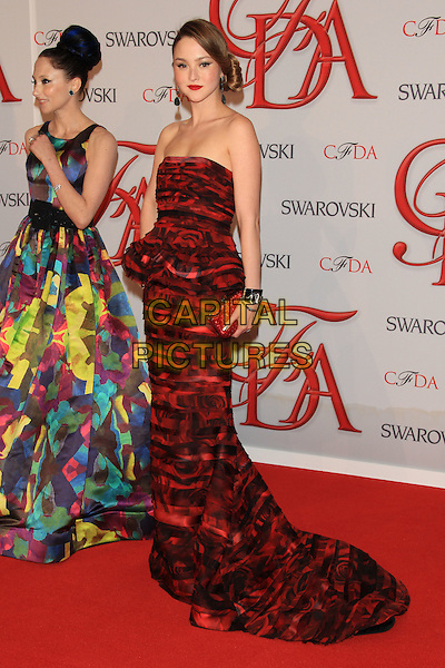 Stacey Bendet & Devon Aoki.The 2012 CFDA Fashion Awards held at Alice Tully Hall - Lincoln Center, New York, NY, USA..June 4th, 2012 .full length dress peplum clutch bag bracelet blue yellow print earrings hair up bun red black print strapless belt.CAP/LNC/TOM.©LNC/Capital Pictures.