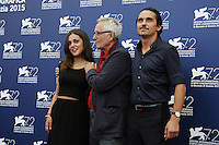 Director Marco Bellocchio, center, attends a photocall with his daughter Elena, left, and his son Pier Giorgio, for the movie 'Blood Of My Blood', during the 72nd Venice Film Festival at the Palazzo Del Cinema in Venice, September 8, 2015.<br /> UPDATE IMAGES PRESS/Stephen Richie