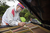"Ethiopia. Southern Nations, Nationalities, and Peoples' Region. Karat village. Konso tribe. Robert Wolken is a professional piano tuner and takes care of Marc Vella's Yamaha Grand Piano. Marc Vella is a french musician and a nomadic pianist. Over the last 25 years he has travelled with his piano in around forty countries to celebrate humanity. Creator of ""La Caravane amoureuse"" (The Caravan of Love) he takes people with him to say ""I love you"" to others and ""lovingly conquered"" their hearts and souls. Piano tuning is the act of making minute adjustments to the tensions of the strings of an acoustic piano to properly align the intervals between their tones so that the instrument is in tune. The Konso, also known as the Konzo, are a Cushitic-speaking ethnic group. Although the Konso people have many customs dating back hundreds of years, it is not uncommon for them to be seen wearing western clothing. The Omo Valley, situated in Africa's Great Rift Valley, is home to an estimated 250,000 individuals of the Konso tribe. Southern Nations, Nationalities, and Peoples' Region (often abbreviated as SNNPR) is one of the nine ethnic divisions of Ethiopia 7.11.15 © 2015 Didier Ruef"