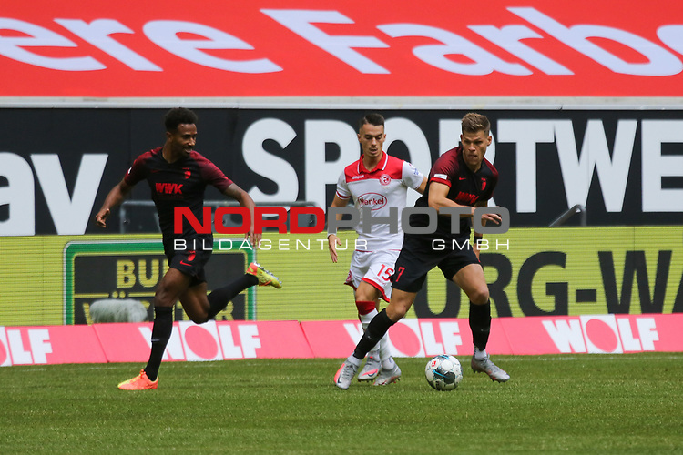 Augsburgs Reece Oxford #36, #Duesseldorfs Erik Thommy #15 und Augsburgs Florian Niederlechner #7<br /><br /><br /><br />(Foto: Sebastian Sendlak / wave.inc/POOL/ via Meuter/Nordphoto)<br /><br />DFL regulations prohibit any use of photographs as image sequences and/or quasi-videos.<br /><br />EDITORIAL USE ONLY<br /><br />National and international News-Agencys OUT.