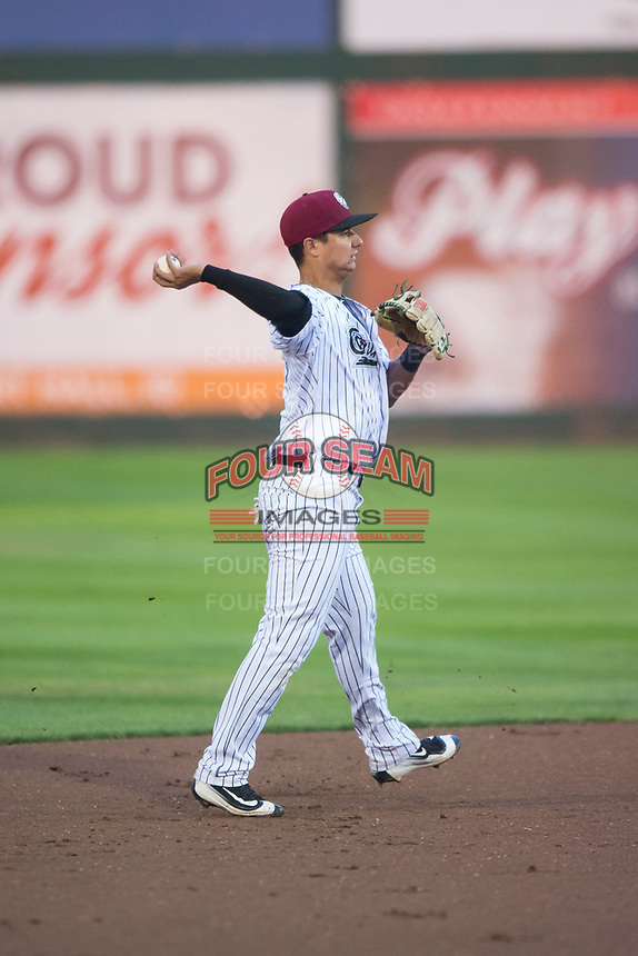 Idaho Falls Chukars second baseman Kyle Kasser (9) throws to first base during a Pioneer League game against the Billings Mustangs at Melaleuca Field on August 22, 2018 in Idaho Falls, Idaho. The Idaho Falls Chukars defeated the Billings Mustangs by a score of 5-3. (Zachary Lucy/Four Seam Images)