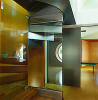 The interior is a combination of reflective surfaces which often visually confuse the graphic layout of the house