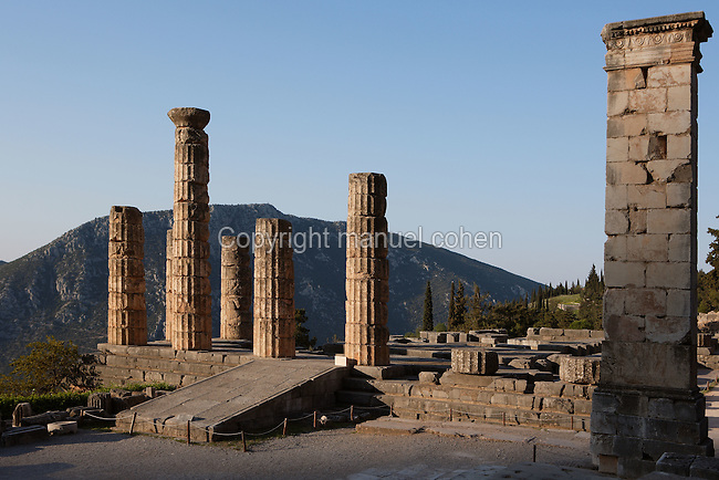 DELPHI, GREECE - APRIL 11 : A general view of the pedestal of the statue of King Prusias II of Bithynia with the Temple of Apollo in the background and the Mount Parnassus in the distance, on April 11, 2007 in the Sanctuary of Apollo, Delphi, Greece. The pedestal dates 2nd century BC and was holding an equestrian statue of King Prusias II of Bithynia. The ruins of the Temple of Apollo belong to the 4th century BC, the third temple built on the site and completed in 330BC. (Photo by Manuel Cohen)
