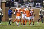 Saul Chinchilla (7) of the Clemson Tigers is congratulated by his teammates after scoring a goal during second half action against the Wake Forest Demon Deacons at Spry Soccer Stadium on November 8, 2017 in Winston-Salem, North Carolina.  The Demon Deacons defeated the Tigers 2-1.  (Brian Westerholt/Sports On Film)