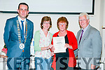 Listowel Tidy Towns Awards: Anne Mullins accepting the Best Residential Presentation in the Hanging Basket/Window box competition at the Listowel Tidy Towns Awards ceremony at the Listowel family resource Centre on Thursday night last. L-R: Mayor Jimmy Moloney, Mary Donoghue, Anne Mullins & Kieran Moloney.