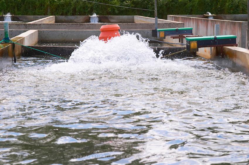 "Fish farm nursery dam pond for breeding sturgeon with fresh water splashing  ""Caviar et Prestige"" Saint Sulpice et Cameyrac  Entre-deux-Mers  Bordeaux Gironde Aquitaine France - at Caviar et Prestige"