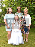 Lily Donnelly from St. Joseph's School who received her first holy communion in St. Joseph's church Mell with her mother Mairead, sister Ella and grandmother Elizabeth Nash. Photo:Colin Bell/pressphotos.ie