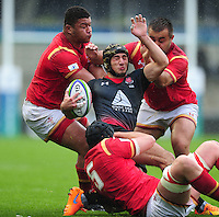 Sandro Merkvilishvili of Georgia U20 is wrapped up by the Wales U20 defence. World Rugby U20 Championship match between Wales U20 and Georgia U20 on June 11, 2016 at the Manchester City Academy Stadium in Manchester, England. Photo by: Patrick Khachfe / Onside Images