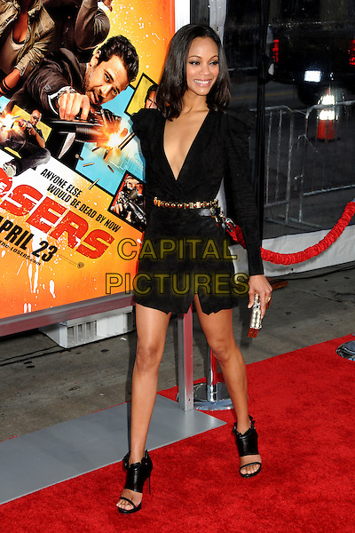 "ZOE SALDANA.""The Losers"" Los Angeles Premiere held at Grauman's Chinese Theatre, Hollywood, California, USA, .20th April 2010..full length black dress low cut plunging neckline shoulder pads sleeves long sleeved gold waist belt clutch bag ankle bootie booties open toe sandals wrap ruched .CAP/ADM/BP.©Byron Purvis/AdMedia/Capital Pictures."