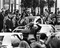 President Gerald Ford ducks behind car after Sara Jane Moore fired a shot. (Ford behind agent with spotted tie). Ford had just exited the St. Francis Hotel in San Francisco when the assassination attempt occured. (photo copyright 1975/Ron Riesterer)