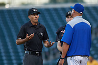 AZL Cubs 1 manager Carmelo Martinez argues a call with umpires Luis Avalos (left) and Cas Cousins (right) during an Arizona League game against the AZL Athletics Gold at Sloan Park on June 20, 2019 in Mesa, Arizona. AZL Athletics Gold defeated AZL Cubs 1 21-3. (Zachary Lucy/Four Seam Images)