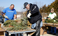 NWA Democrat-Gazette/DAVID GOTTSCHALK Daniel Todd (from left) and Ed Harkreader remove wiring from wreaths Friday, March 9, 2018, during the the 6th annual Wreath Recycling Project for Bo's Blessings at the Arkansas National Guard Armory in Fayetteville. Bo's Blessings LUTHAB, Inc., collects and then removes the wiring and bows on more than 8,500 wreaths that were distributed on the grave sites at the Fayetteville National Cemetery. The greenery will be used mulch and wire will be collected by the city of Fayetteville Recycling and Trash Collections.