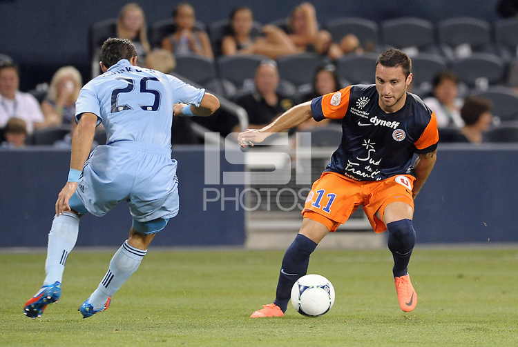 Emanuel Herrera (11) forward Montpellier facing Neven Markovic (25) defender Sporting KC..Sporting Kansas City were defeated 3-0 by Montpellier HSC in an international friendly at LIVESTRONG Sporting Park, Kansas City, KS..