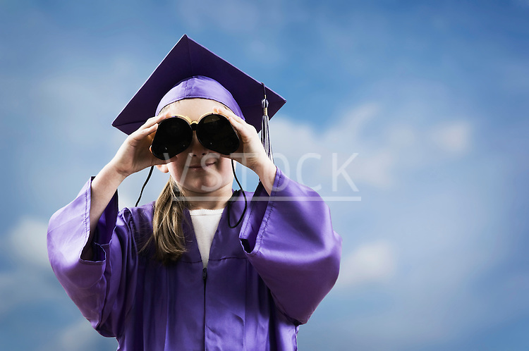 Cassidy Vote horizontal girl looking through binoculars lifestyle 5 6 7 years kid child person childhood female white caucasian future concept idea cap gown mortarboard hat graduate graduation graduating school schooling education knowledge learning achievement student pupil success successful achievement goal