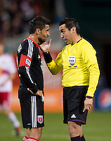 Marcelo Saragosa (11) of D.C. United discusses a call with referee Jair Marrufo during the game at RFK Stadium in Washington DC. D.C. United tied New York Red Bulls, 1-1.