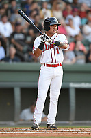 Second baseman Carlos Tovar (11) of the Greenville Drive bats in a game against the Kannapolis Intimidators on Wednesday, July 12, 2017, at Fluor Field at the West End in Greenville, South Carolina. Greenville won, 12-2. (Tom Priddy/Four Seam Images)