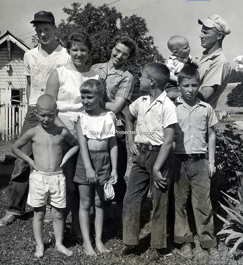 Riesterer familyL-R..Red, Clare, Mom,Dad holding Jim,(bottom) Doug, Mary (Pidge), Ken &amp; Mike..<br />