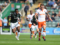 Blackpool's Harry Pritchard under pressure from Plymouth Argyle's Yann Songo'o<br /> <br /> Photographer Kevin Barnes/CameraSport<br /> <br /> The EFL Sky Bet League One - Plymouth Argyle v Blackpool - Saturday 15th September 2018 - Home Park - Plymouth<br /> <br /> World Copyright &copy; 2018 CameraSport. All rights reserved. 43 Linden Ave. Countesthorpe. Leicester. England. LE8 5PG - Tel: +44 (0) 116 277 4147 - admin@camerasport.com - www.camerasport.com
