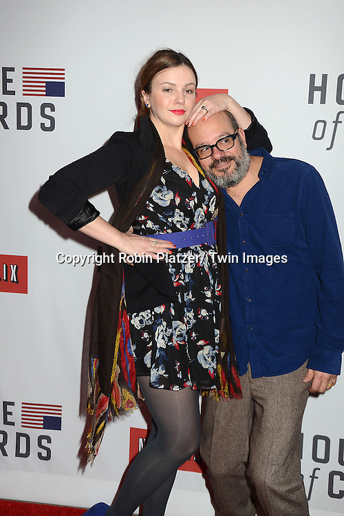 "Amber Tamblyn and husband David Cross  attends the Premiere of ""House of Cards"" on January 30, 2013 at Alice Tully Hall at Lincoln Center in New York City. The movie is available to watch on Netflix on February 1, 2013. The show stars Kevin Spacey, Kate Mara, Robin Wright, Michael Kelly, Corey Stoll, Kristen Connoly, Sakina Jaffrey, Constance Zimmer and  Sandrine Holt."