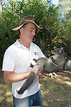 David Lindenmayer Holding Mountain Brushtail Possum