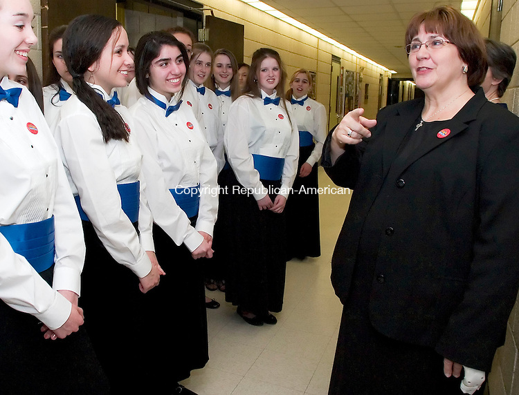 WOODBURY, CT- 27 MARCH 07- 032707JT02- <br /> Vocal teacher Lynn Kearney speaks to the Nonnewaug High School Concert Chorus in a hallway of the school before they perform at the third annual Region 14 regional choral concert on Tuesday night. The concert included choruses from grades 5 through 12 from Bethlehem Elementary School, Mitchell Elementary School, Woodbury Middle School and Nonnewaug High School. Nonnewaug will host a similar concert Wednesday night featuring instrumental bands from the region's schools.<br /> Josalee Thrift Republican-American