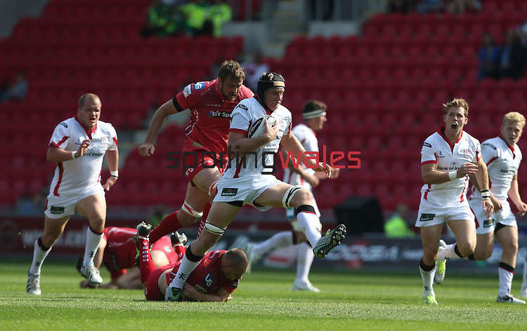 Guiness Pro12<br /> Ulster lock Franco Van Der Merwe skips through the diving tackle of Scarlets hooker Ken Owens<br /> Scarlets v Ulster<br /> Parc y Scarlets<br /> <br /> 06.09.14<br /> ©Steve Pope-SPORTINGWALES