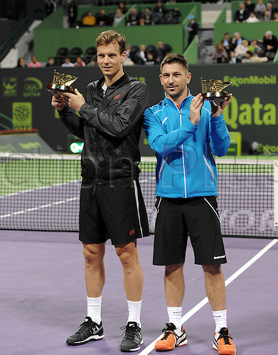 03.01.2014. Doha, Qatar.  Tomas Berdych (L) and Jan Hajek of Czech Republic pose with their trophies after the mens doules final against Alexander Peya of Austria and Bruno Soares of Brazil in Qatar Open tennis tournament, Jan. 3, 2014. Tomas Berdych and Jan Hajek won 2-0.