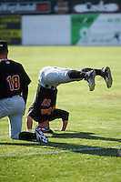 West Virginia Black Bears Hunter Owen (37) does a headstand during warmups before a game against the Batavia Muckdogs on June 29, 2016 at Dwyer Stadium in Batavia, New York.  West Virginia defeated Batavia 9-4.  (Mike Janes/Four Seam Images)