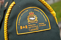 Canada Fisheries and Oceans badge is seen during a police memorial parade in Ottawa Sunday September 26, 2010.