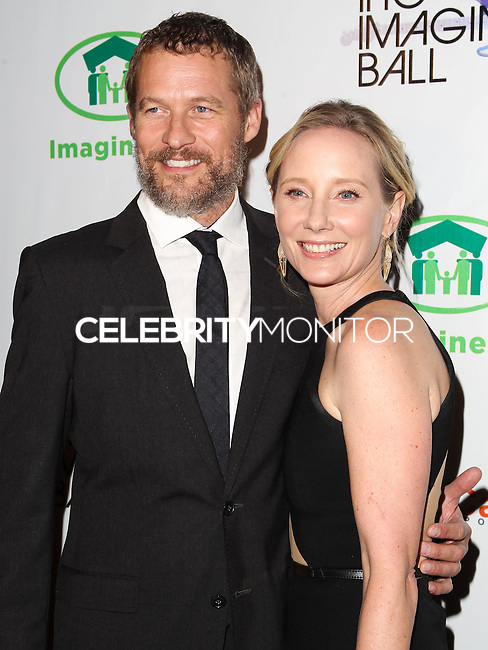 WEST HOLLYWOOD, CA, USA - AUGUST 06: James Tupper, Anne Heche at The Imagine Ball Presented By John Terzian & Randall Kaplan Benefiting Imagine LA held at the House of Blues Sunset Strip on August 6, 2014 in West Hollywood, California, United States. (Photo by Celebrity Monitor)