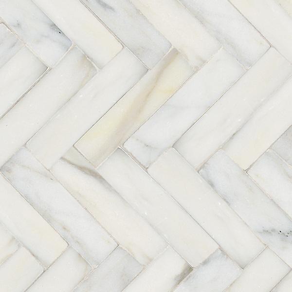 "Herringbone 3"" x 12"", a hand-cut stone mosaic, shown in polished in Calacatta Tia."