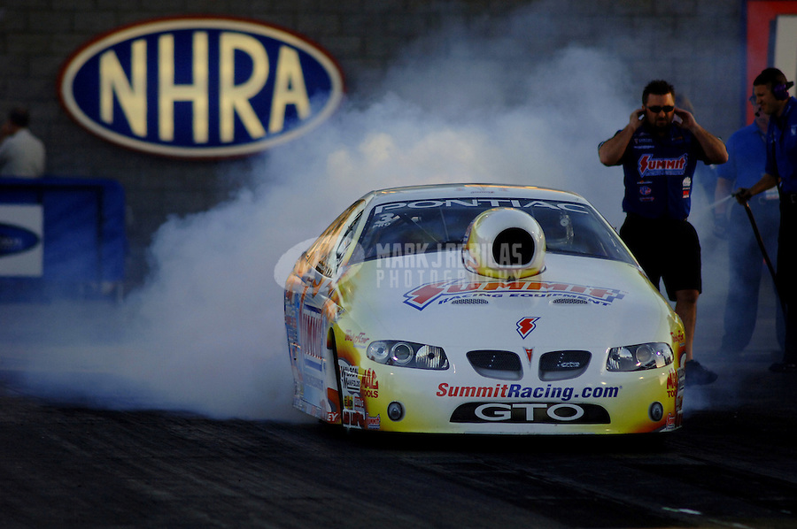 Apr 7, 2006; Las Vegas, NV, USA; NHRA Pro Stock driver Jason Line does a burnout in the Summit Racing Pontiac GTO during qualifying for the Summitracing.com Nationals at Las Vegas Motor Speedway in Las Vegas, NV. Mandatory Credit: Mark J. Rebilas