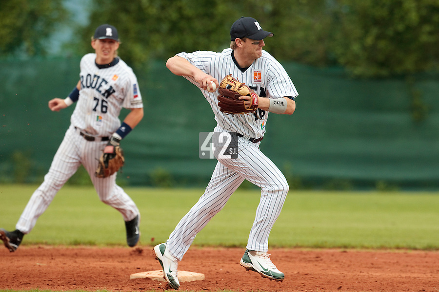 03 June 2010: Shortstop Aaron Hornostaj of Rouen throws the ball to first base during the 2010 Baseball European Cup match won  8-4 by C.B. Sant Boi over the Rouen Huskies, at the Kravi Hora ballpark, in Brno, Czech Republic.