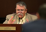 Nevada Sen. Pete Goicoechea, R-Eureka, works in a committee hearing at the Legislative Building in Carson City, Nev., on Friday, April 3, 2015. <br /> Photo by Cathleen Allison