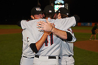 Tri-City ValleyCats pitchers Zac Person (29), Ralph Garza (41) and Kevin McCanna (47) embrace after a game against the Aberdeen Ironbirds on August 6, 2015 at Ripken Stadium in Aberdeen, Maryland.  Tri-City defeated Aberdeen 5-0 as the trio combined to throw a no-hitter.  (Mike Janes/Four Seam Images)
