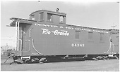 Side view of long caboose #04343, flying herald, round roof at Alamosa.<br /> D&amp;RGW  Alamosa, CO  Taken by Richardson, Robert W. - 1/1950