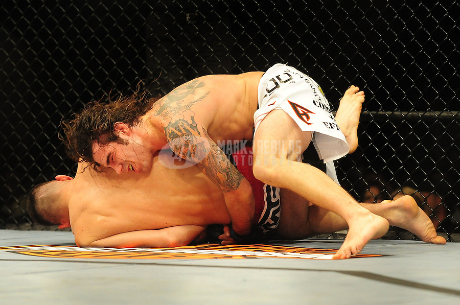 Jan. 31, 2009; Las Vegas, NV, USA; UFC fighter Clay Guida (white trunks) against Nate Diaz (red trunks) during the lightweight bout in UFC 94 at the MGM Grand Hotel and Casino. Guida defeated Diaz on a split decision. Mandatory Credit: Mark J. Rebilas-