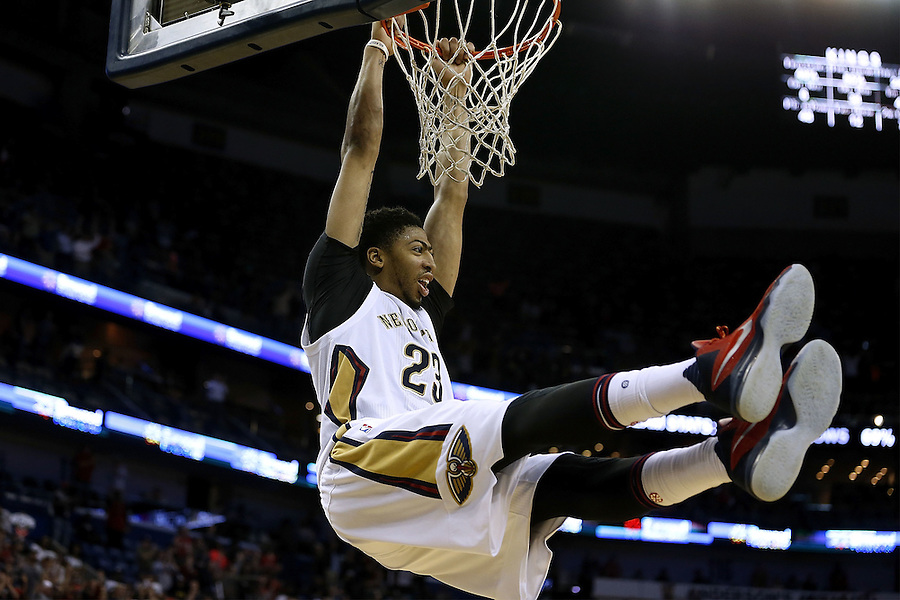 NEW ORLEANS, LA - MARCH 07:  Anthony Davis #23 of the New Orleans Pelicans hangs from the rim after a game at Smoothie King Center on March 7, 2016 in New Orleans, Louisiana. NOTE TO USER: User expressly acknowledges and agrees that, by downloading and or using this photograph, User is consenting to the terms and conditions of the Getty Images License Agreement. (Photo by Jonathan Bachman/Getty Images)