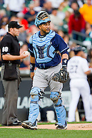 Tampa Bay Rays catcher Jose Molina (28) walks off the field at the end of an inning in the Major League Baseball game against the Detroit Tigers at Comerica Park on June 4, 2013 in Detroit, Michigan.  The Tigers defeated the Rays 10-1.  Brian Westerholt/Four Seam Images