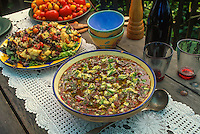 Fresh gazpacho made from home grown tomatoes on farm table with tomato bread salad in recipe;  Michele Anna Jordon garden