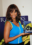 BAL HABOUR, FL - SEPTEMBER 19: Tyra Banks greets fans and signs copies of her book 'Modelland' at Neiman Marcus for Books and Books at Bal Harbour Shops on September 19, 2011 in Miami, Florida. (Photo by Johnny Louis/jlnphotography.com)