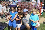 Actor Mark Feuerstein of USA's Royal Pains poses with his family - L to R: daughter Lila, wife Dana, daughter Addie, son Frisco as he played in the Artists vs. Writers 64th Annual Celebrity Softball Game on August 25, 2012 at Herrick Park, East Hampton, New York benefiting East End Hospice, East Hampton Day Care Learning Center, Phoenix Houses of Long Island and The Retreat.  (Photo by Sue Coflin/Max Photos)